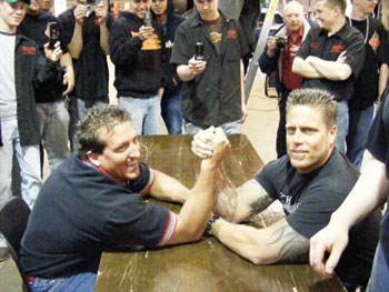 Rich Evans of Huntington Beach Bodyworks and Waubonsee Community College automotive course instructor Ken Kunz prepare to do battle – arm wrestling style.