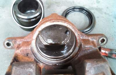 Example of how flushing brake fluid after caliper installation can ruin a brake job. After four months, dirty brake fluid caused the seal to leak. Image courtesy of Undercar Express LLC.