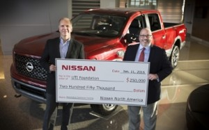 Nissan North America executives Warren DeBardelaben, Director, Dealer Support, (L) and Wally Burchfield, Vice President, Aftersales Division, present a check for $250,000 to the UTI Foundation to fund scholarships for students who wish to pursue careers as automotive technicians. Nissan has supported the UTI Foundation with more than $1.2 million in scholarship donations over the past seven years.