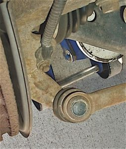 Photo 3: Steering arm angle (center) and tie rod mounting angle should appear normal at the steering knuckle.