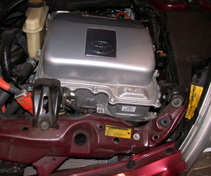 photo 3: the inverter/converter assembly in this prius is located at the top of the engine compartment near the radiator support, making it susceptible to damage in the event of a front-end impact such as this.