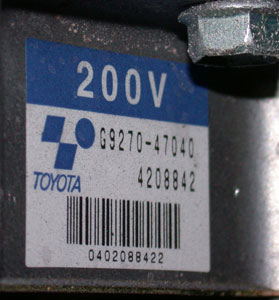 Photo 6: Note that the label on the inverter/converter of this Prius rates the high-voltage system at 200 volts, which is more than enough to kill you instantly.