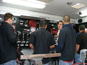 wcc students check out tools and  equipment in the chicago pneumatic mobile tool trailer. the school was awarded $7,000 worth of chicago pneumatic tools and other items commemorating their winning the inaugural t2 school of year award.