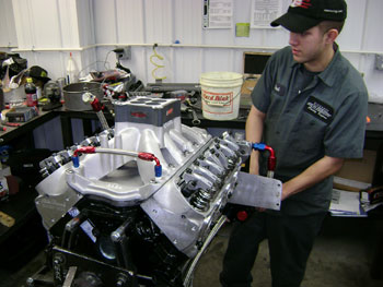 this engine tech is putting the finishing  touches on a 400-plus cubic inch small-block ford. ford small-blocks have more deck height to work with than small-block chevys and a little more room inside of the crankcase.