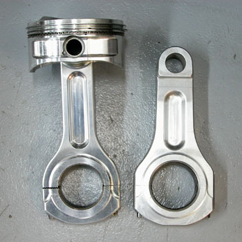 aluminum rods are difficult to use in stroker engines because they have more mass and usually cause interference in the cam and cylinder bore area. the rod on the left has more clearance than the rod on the right, but it is also weaker.
