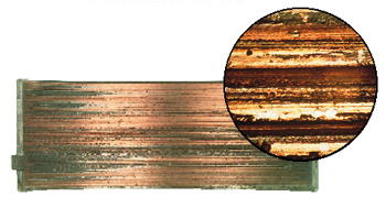 figure 1: overplated copper alloy bearing gouged by cast iron debris. inset photo shows the microscopic detail of the gouges.  (courtesy of federal-mogul)