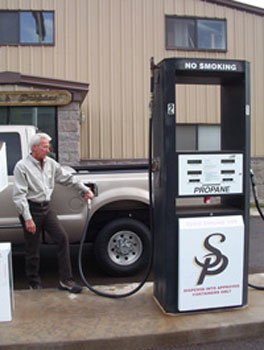 photo 2: propane-powered vehicles' power, acceleration and cruising speed are similar to those of gasoline powered vehicles. shown here, an employee of superior propane fuels his vehicle in williams, az.