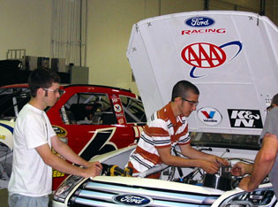 Chris Cheek (left) and Paul Bretl (right) from Grafton, Wis., work on a Roush Fenway Racing race car during their dream learning experience with Roush Fenway Racing in 2008.