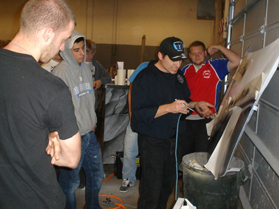 Artist/instructor Richard Markham with Ohio Technical College (OTC) students.