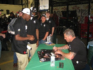 Following the presentations, Rich Evans of Huntington Beach Bodyworks, autographed posters and spoke one-on-one with the auto students.