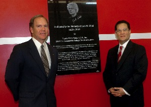 Bill Bergen (left), Toyota's national dealer education manager, joins Shoreline Community College president Lee Lambert at a plaque honoring the late Jack Shiel, the school's first automotive technology and Toyota T-TEN instructor. Shiel's plaque was in place for a June 8 ribbon cutting marking opening of a 26,000 sq. ft., $4.2 million expansion at the college's state-of-technology Professional Automotive Training Center.