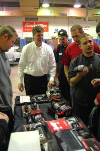 steve rabung, western regional manager for chicago pneumatic, (center) talks to acc students about the tools the auto program was awarded for being the 2011 school of the year.